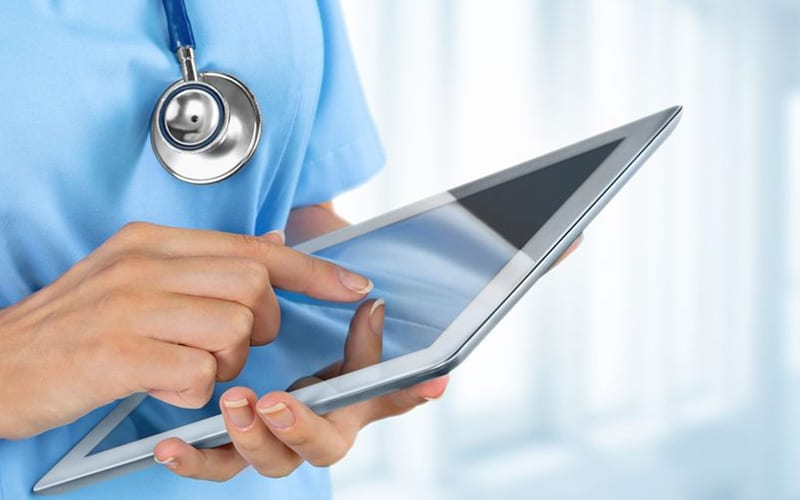 Healthcare Doctor Using Tablet