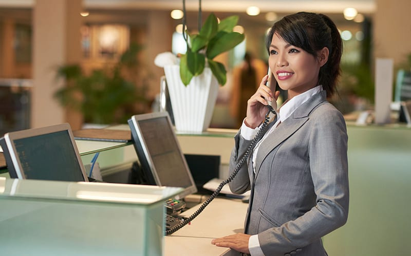 Smiling Concierge Answering Phone Hospitality