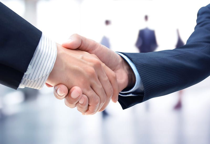 Businessmen shaking hands merger acquisition