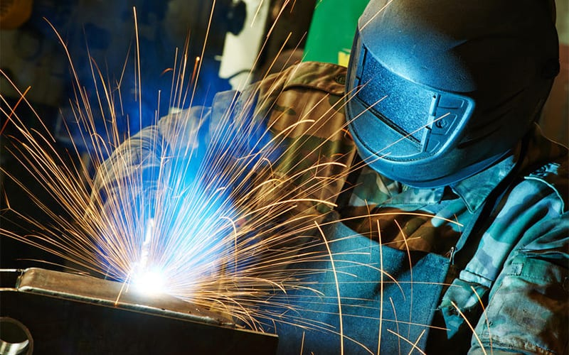Manufacturer Welding with Sparks Photo