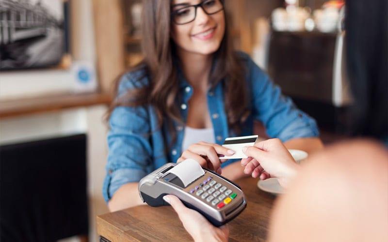 Smiling Customer Retail Transaction Credit Card Receipt