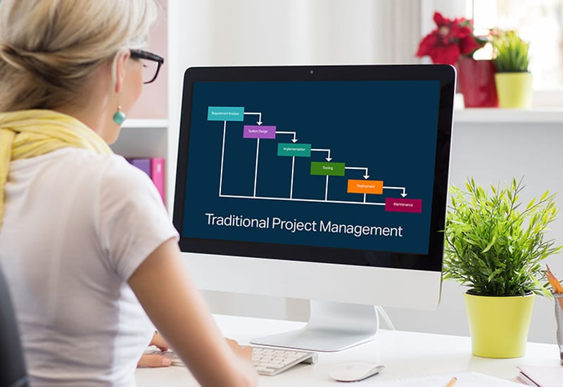 Traditional project planning with waterfall diagram on monitor