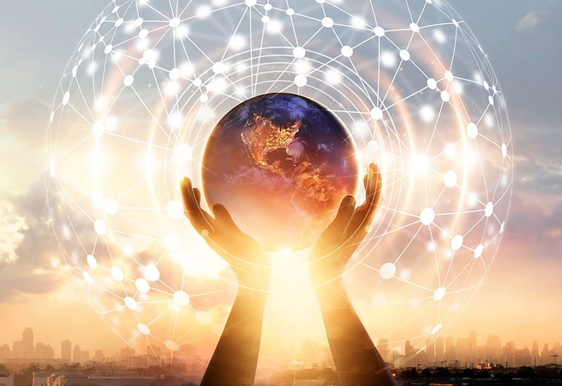 Hands touching earth and circle global network connection